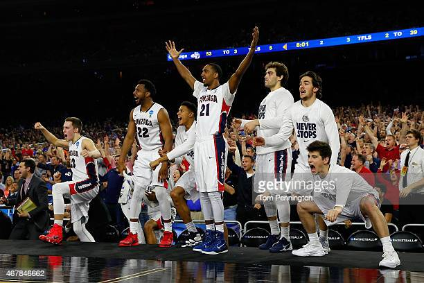 The Gonzaga Bulldogs bench reacts against the UCLA Bruins during a South Regional Semifinal game of the 2015 NCAA Men's Basketball Tournament at NRG...