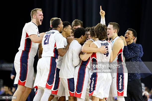 The Gonzaga Bulldogs celebrate after defeating the UCLA Bruins 7462 during a South Regional Semifinal game of the 2015 NCAA Men's Basketball...