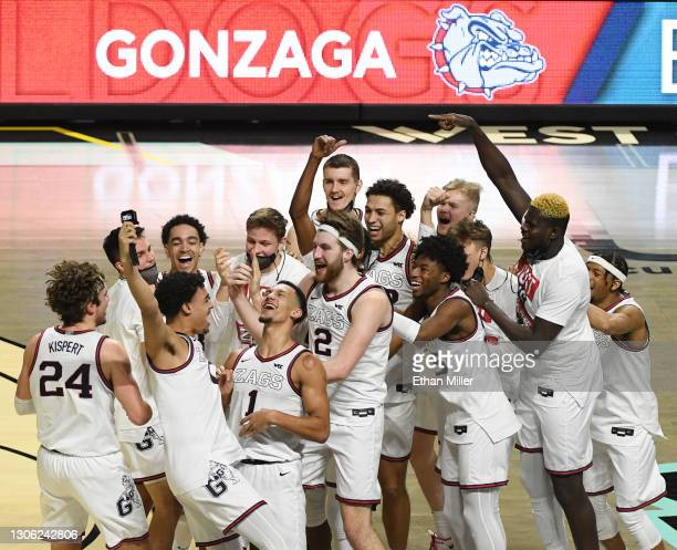 The Gonzaga Bulldogs celebrate on the court after their 88-78 victory over the Brigham Young Cougars to win the championship game of the West Coast...
