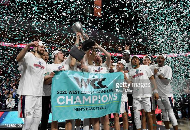 The Gonzaga Bulldogs celebrate with the trophy after defeating the Saint Mary's Gaels 84-66 to win the championship game of the West Coast Conference...
