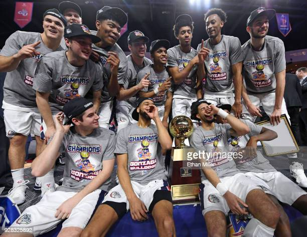The Gonzaga Bulldogs celebrate with the trophy after defeating the Brigham Young Cougars 7454 to win the championship game of the West Coast...