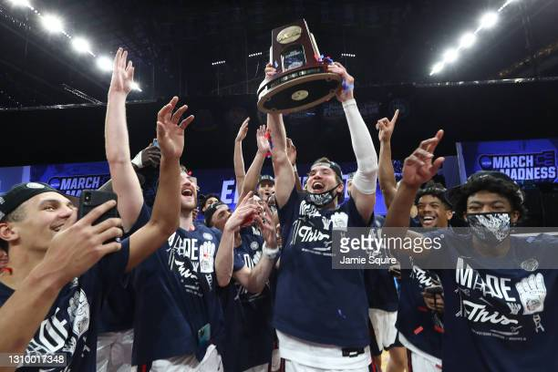 The Gonzaga Bulldogs celebrate with the West Regional Champion trophy after defeating the USC Trojans 85-66 in the Elite Eight round game of the 2021...