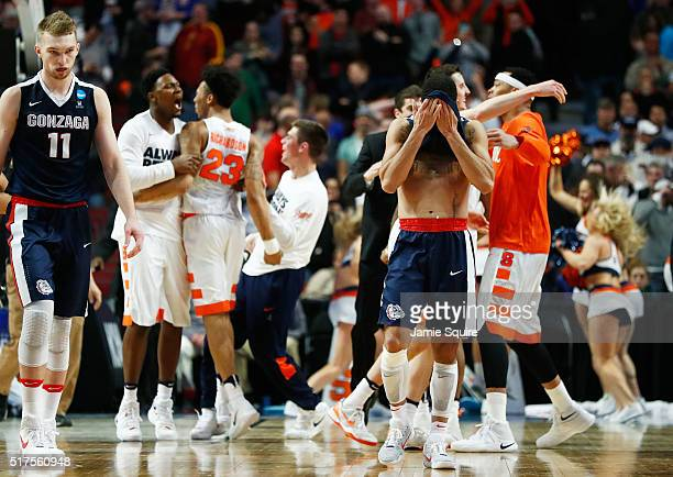 The Gonzaga Bulldogs react as the Syracuse Orange celebrate their 63 to 60 win during the 2016 NCAA Men's Basketball Tournament Midwest Regional at...