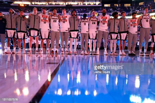 The Gonzaga Bulldogs stand for the national anthem ahead of the National Championship game of the 2021 NCAA Men's Basketball Tournament against the...