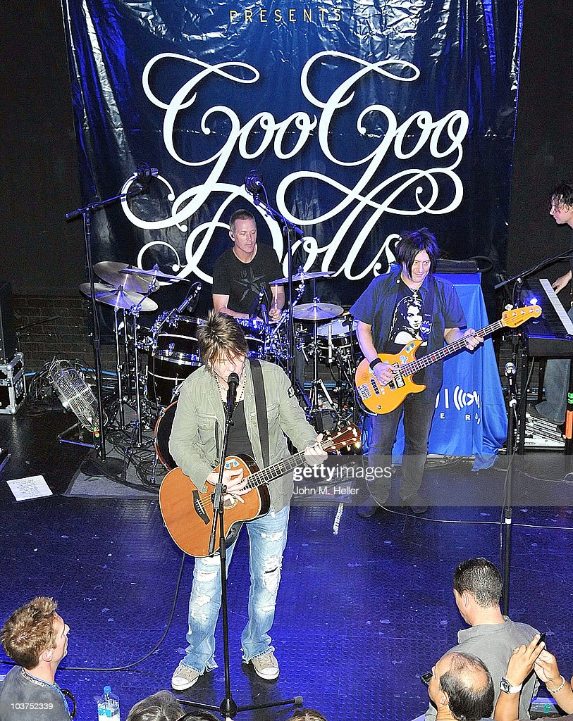 The Goo Goo Dolls drummer Mike Malinin, keyboardist Korel Tunador, (Front Row L-R) lead vocalist John Rzeznik and bass guitarist Robby Takac perform as part of SIRIUS XM's Coffee House Live series at the Troubadour on August 31, 2010 in Los Angeles, California.