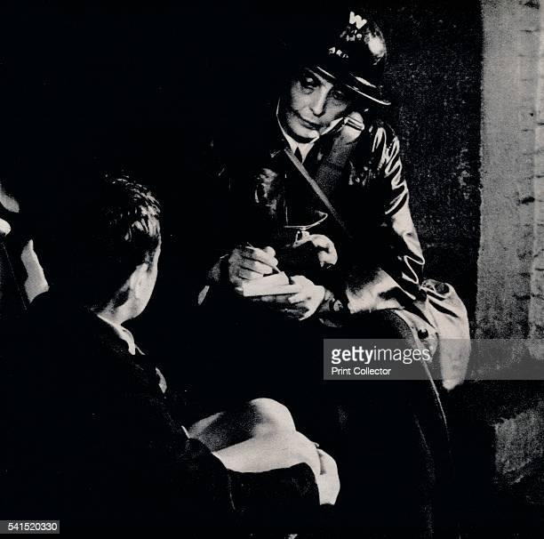 The Good Neighbour' c1941 A female Air Raid Warden comforts a victim of the blitz Air Raid Precautions was an organisation in the United Kingdom set...