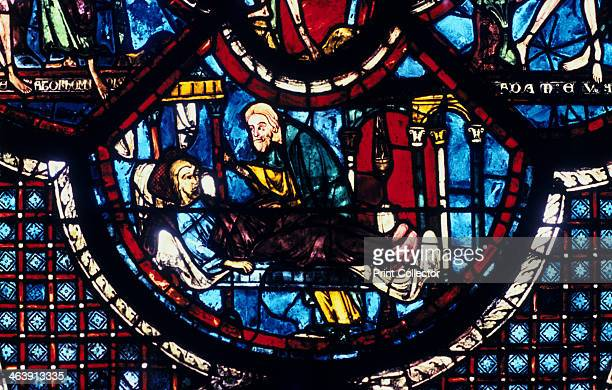 The Good Samaritan cares for the Pilgrim stained glass Chartres Cathedral France 12051215 From the Good Samaritan and Adam and Eve window in the...