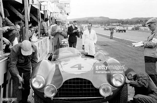 The Goodwood 9 Hours Race Goodwood August 22 1953 Mechanics change the front wheels of the Aston Martin DB3S driven by Eric Thompson with Reg Parnell...