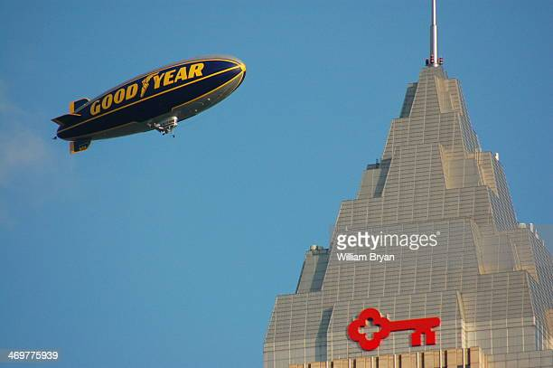 The Goodyear blimp soars above the Key Bank office tower on Public Square in downtown Cleveland on an August afternoon in 2009.