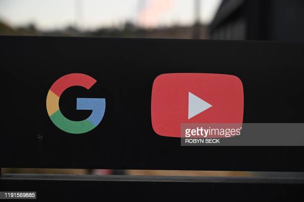 The Google and YouTube logos are seen at the entrance to the Google offices in Los Angeles, California, November 21, 2019. - YouTube Space LA is one...