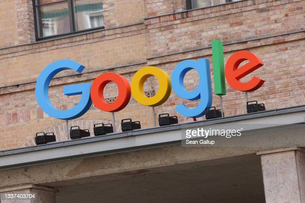 The Google corporate logo hangs outside the Google Germany offices on August 31, 2021 in Berlin, Germany. Google has announced it will invest EUR one...