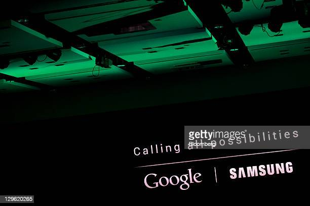 The Google Inc and Samsung Electronics Co Ltd logos are displayed at the launch of Samsung's Galaxy Nexus smartphone running Google's Ice Cream...