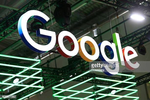 The Google Inc logo hangs illuminated over the company's exhibition stand at the Dmexco digital marketing conference in Cologne Germany on Wednesday...