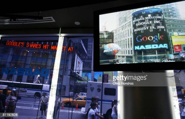 The Google logo appears on a screen and ticker inside the NASDAQ Marketsite just before the markets close August 19 2004 in New York City Shares of...