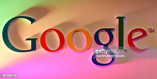 The Google logo is displayed during the 'Google Impact Challenge Japan' final event in Tokyo on March 26 2015 AFP PHOTO / TOSHIFUMI KITAMURA
