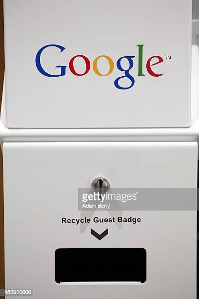 The Google logo is seen on a guest badge recycling machine in the company's offices on August 21 2014 in Berlin Germany Google reported last month...