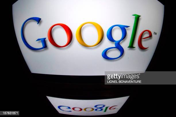 The 'Google' logo is seen on a tablet screen on December 4 2012 in Paris AFP PHOTO / LIONEL BONAVENTURE