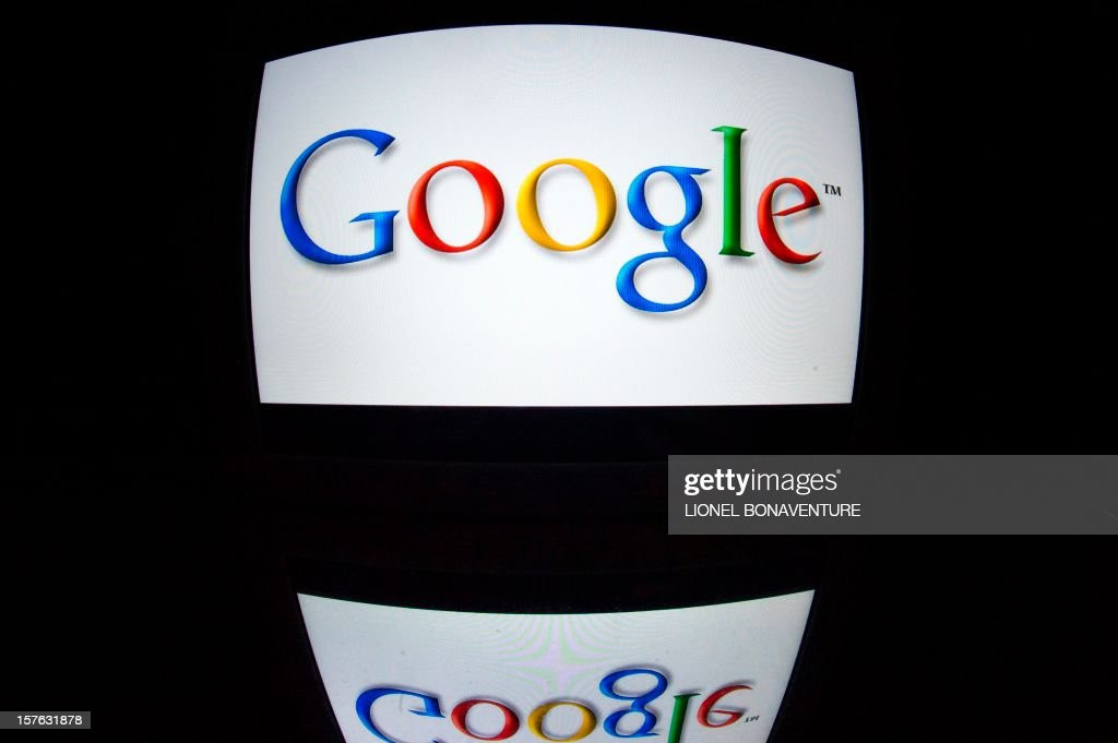 The 'Google' logo is seen on a tablet screen on December 4, 2012 in Paris.