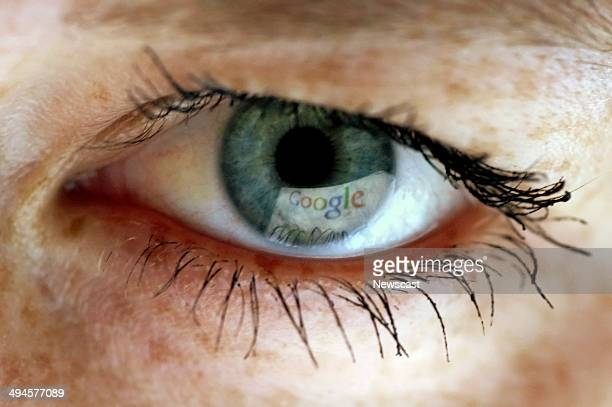The Google search engine webpage being reflected in an eye.