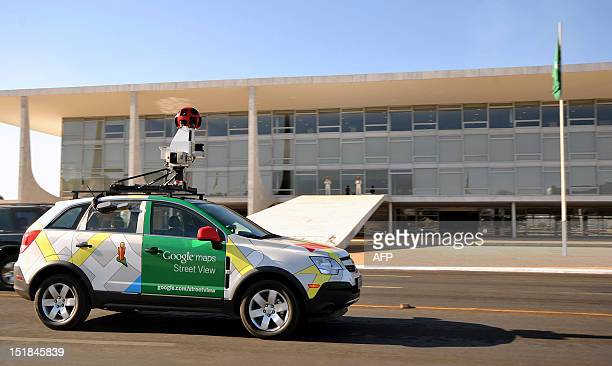 The Google street view mapping and camera vehicle drives in front of the Planalto Palace as it charts the streets of Brasília Brazil's capital on...