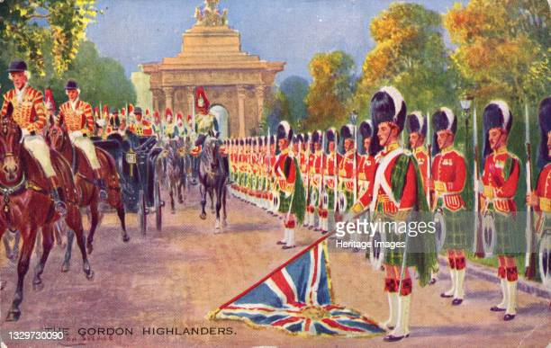 The Gordon Highlanders, 1936. Scottish regiment lowering the Union flag as the royal carriage passes along Constitution Hill in London. In the...