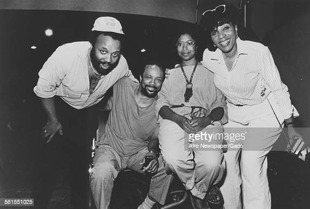 The gospel singer Andrae Crouch with three other people posing for a photograph 2011