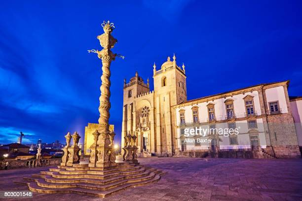 the gothic porto cathedral illuminated at dusk - pillory stock photos and pictures