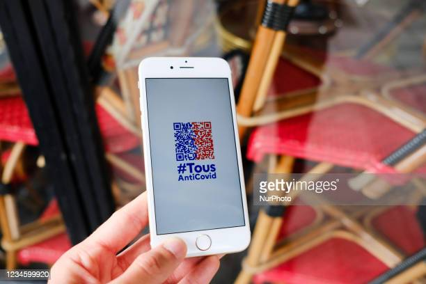 The government application Tous AntiCovid allows you to scan your health pass at the entrance of restaurants, cinema, museums in Paris, France, on...