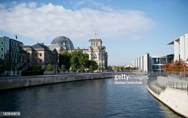 The government district next to river Spree with several buildings of the German Bundestag Parliamentary Association The Reichstag PaulLoebeHaus and...