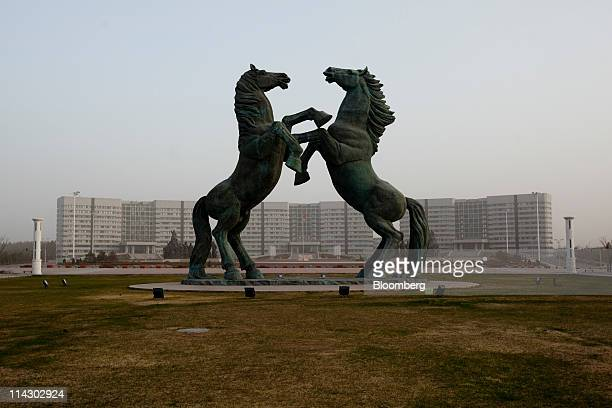 The government headquarters stand in the new district of Kangbashi in Ordos Inner Mongolia China on Saturday April 30 2011 Designed for 300000 people...