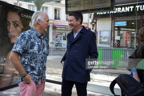 The government spokesman and potential candidate for mayor of Paris in 2020 Benjamin Grivaux is photographed for Paris Match talking with man on...
