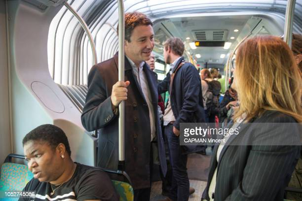 The government spokesman and potential candidate for mayor of Paris in 2020 Benjamin Grivaux is photographed for Paris Match talking with a woman in...