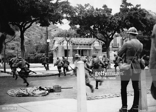 The government troops storm a rebel communist position in Rio de Janeiro Brazil Nov 27 1935