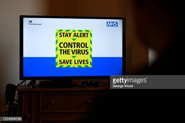 "The government's new slogan ""Stay Alert, Control the Virus, Save Lives"" is seen during Britain's Prime Minister Boris Johnson's televised message to..."