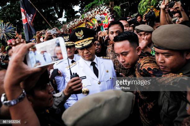 The Governor of Jakarta Anies Baswedan and Deputy Governor Sandiaga Uno were paraded from the Presidential Palace to the City Hall during the...