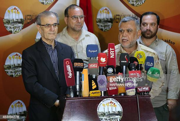 The governor of Kirkuk and head of the security committee Najm al-Din Omar and minister of transportation, Hadi al-Ameri give a joint press...