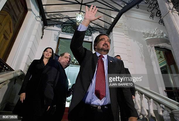 The governor of New Mexico Bill Richardson waves to the press upon his arrival to the Miraflores presidential palace in Caracas on April 26 2008...