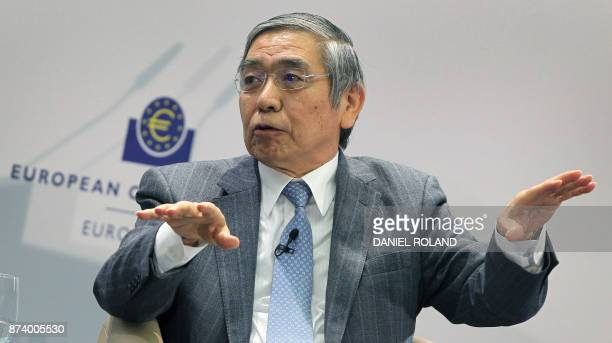"""The governor of the Bank of Japan Haruhiko Kuroda speaks as he attends a conference titled """"Communications Challenges for Policy Effectiveness""""..."""