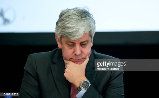The Governor of the Bank of Portugal Mário Centeno reads some papers after delivering an opening statement during a press conference on the...