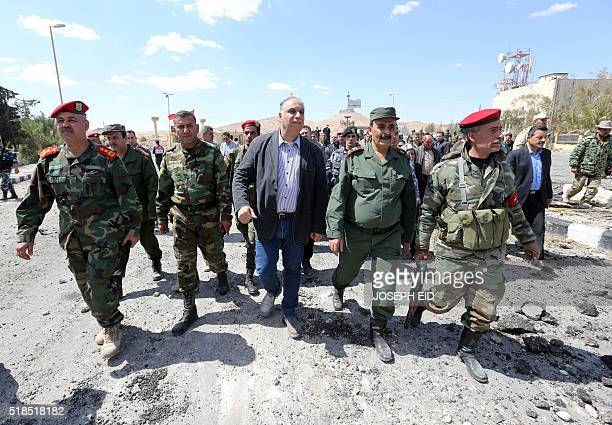 The Governor of the Syrian province of Homs Talal Barazi visits the ancient city of Palmyra some 215 kilometres northeast of Damascus on March 31...