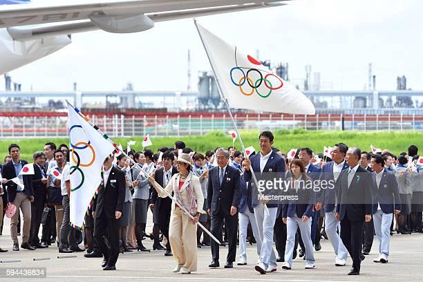 The governor of Tokyo Yuriko Koike with the Olympic flag Rio de Janeiro Olympic Japan squad Subcaptain Keisuke Ushiro with the JOC flag and Team...