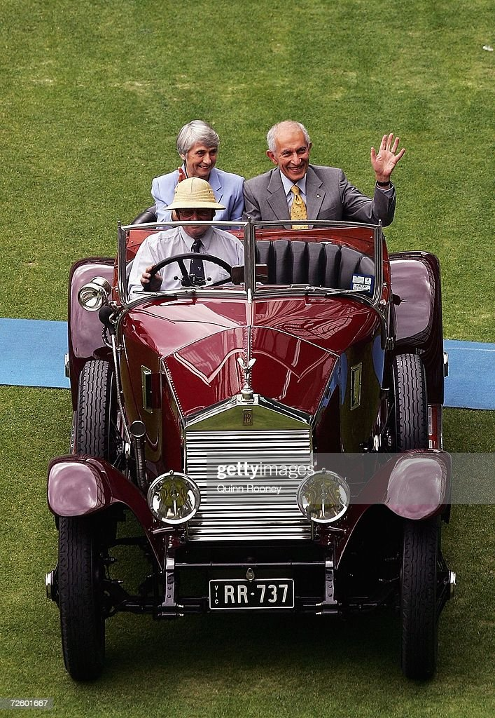 The Governor of Victoria David de Kretser waves to the crowd during the 50th anniversary of the 1956 Melbourne Olympic Games at the Melbourne Cricket Ground November 19, 2006 in Melbourne, Australia.