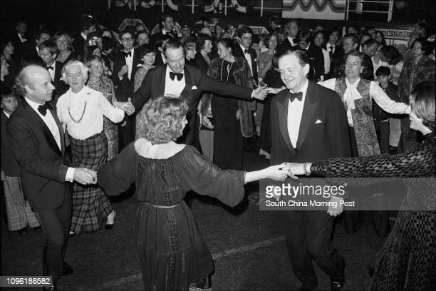 The Governor Sir Murray MacLehose becomes the focus of a dancing ring at Jardine Matheson's annual ball held at New Year's Eve Also dancing merrily...