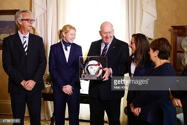 The Governor-General of Australia Sir Peter Cosgrove and Lady Cosgrove accept a gift from Australian Matildas co-captains Clare Polkinghorne and Lisa...