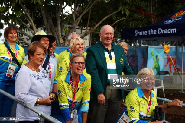 The GovernorGeneral Sir Peter Cosgrove and his wife Lynne Cosgrove pose with volunteers as they arrive at the hockey on day one of the Gold Coast...
