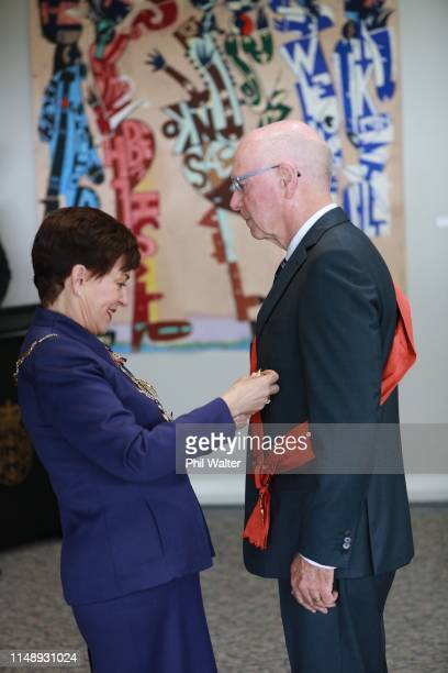 The GovernorGeneral The Rt Hon Dame Patsy Reddy presents Sir Stephen Tindall with the Insignia Of A Knight Grand Companion Of The New Zealand Order...