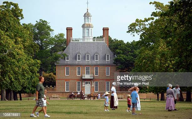 The Governor's Palace is seen in the background as period actors play on the greens on July 31 2010 in Williamsburg Va