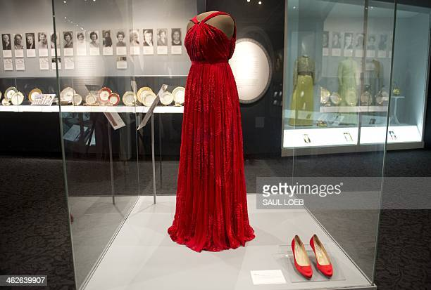 The gown and shoes worn by US First Lady Michelle Obama during the inaugural balls for US President Barack Obama's second inauguration are on display...