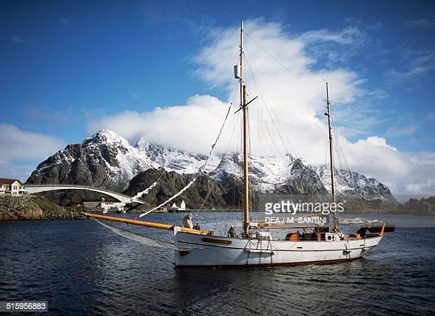 The Goxheim sailboat with the peaks of Lofotenveggen in the background Henningsvaer Austvagoy Lofoten islands Nordland county Norway