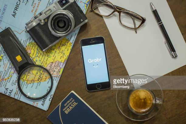 The Grabr Inc application is displayed on an Apple Inc iPhone in an arranged photograph taken in Sao Paulo Brazil on Wednesday March 14 2018 Grabr a...